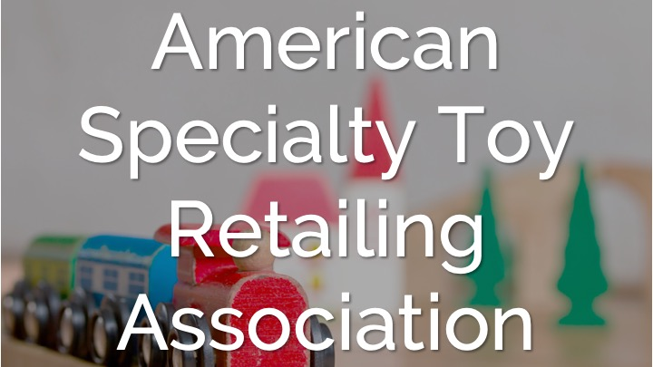 An image showing a toy train background with a word American Specialty Toy Retailing Association